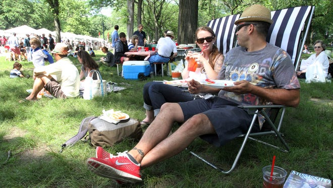 Julia Valenti, foreground left, and her husband Phil Valenti, right, from Bayport, N.Y., partake of the food and beverages at the 35th Annual Mississippi Picnic in New York's Central Park in 2014. Julia is originally from Jackson, Mississippi.