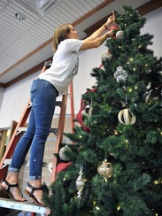 Lauren Wuthrich decorates one of several Christmas