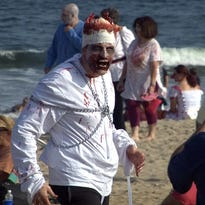 Zombies leave the VFW hall and take to the streets of Asbury Park during the First  Asbury Park Zombie Walk in 2008.