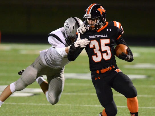 Plymouth's Joey Ahearn (left) closes in on Northville's