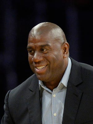Oct 28, 2014; Los Angeles, CA, USA; Los Angeles Lakers former player Magic Johnson in attendance during the game between the Los Angeles Lakers and the Houston Rockets at Staples Center. Mandatory Credit: Richard Mackson-USA TODAY Sports