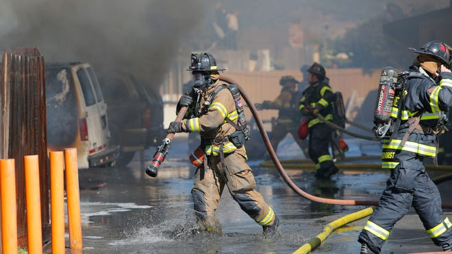 In this file photo, Salinas firefighters respond to a structure fire. Salinas firefighters, frustrated with pay and overtime shifts, have served the city a binding arbitration notice in hopes of reaching an agreement in contract negotiations.