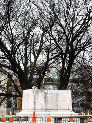 Only the pedestal remains of the removed statue of Nathan Bedford Forrest at Health Sciences Park on Thursday morning. The city of Memphis sold two public parks containing Confederate monuments to a nonprofit Wednesday in a massive, months-in-the-planning operation to take the statues down overnight.