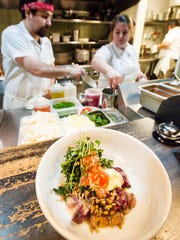 A wilted kale salad with beets, cranberry beans, sunflower seeds, mascarpone and apple vinaigrette prepared by Chef Jackie Major at Butch and Babe's in Burlington on Thursday, February 1, 2018.
