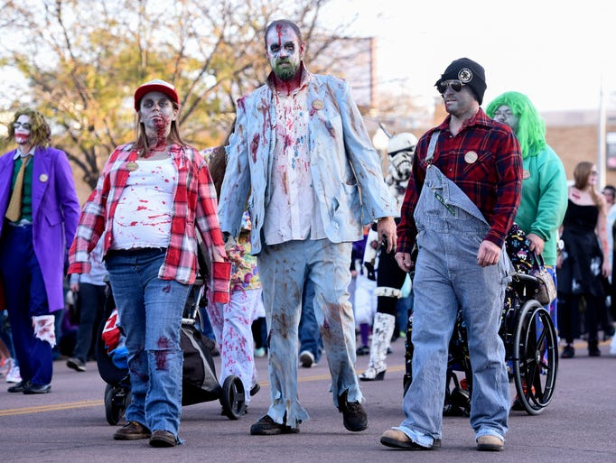Zombies walk down 1st Avenue during the Zombie Walk
