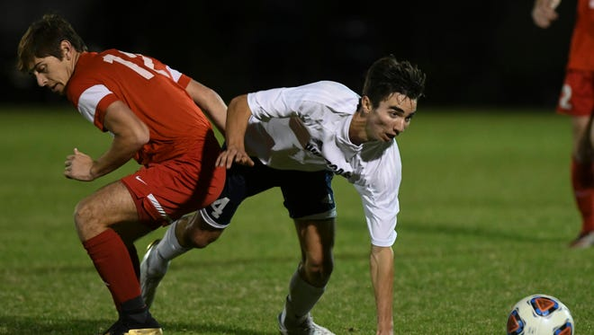 Gabe Nackashi of Bishop Kenny (12) and West Shore's Abe Murphy battle for the ball during Friday's Class 3A state soccer semifinal.