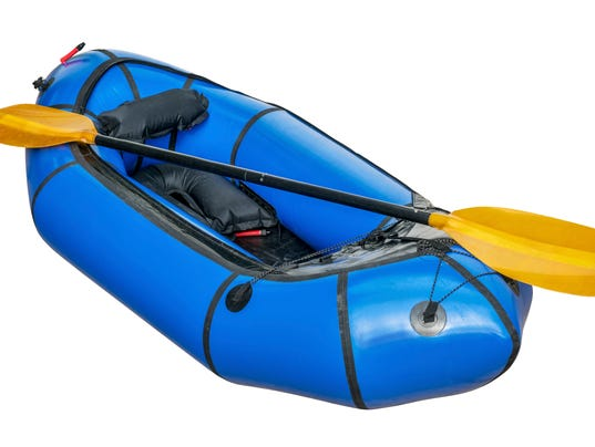 blue packraft isolated
