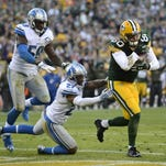 Green Bay Packers tight end Justin Perillo (80) makes a touchdown catch past Detroit Lions safety Glover Quin (27) and linebacker Tahir Whitehead (59) in the fourth quarter during Sunday's game at Lambeau Field.