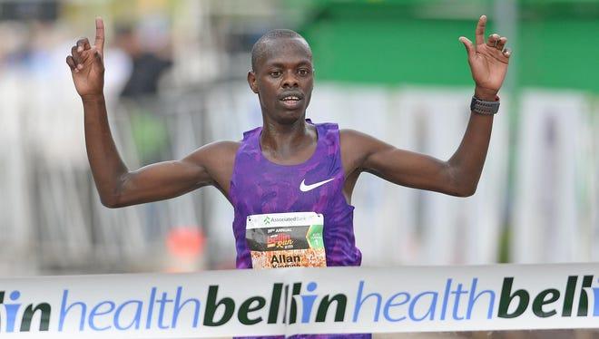Allan Kiprono crosses the finish line to win his fourth Bellin Run title in five years.