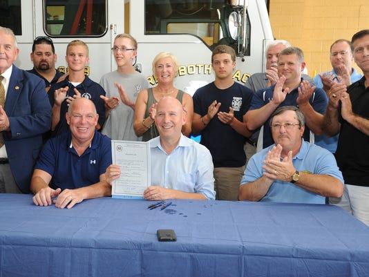 firefighter.bill.signing