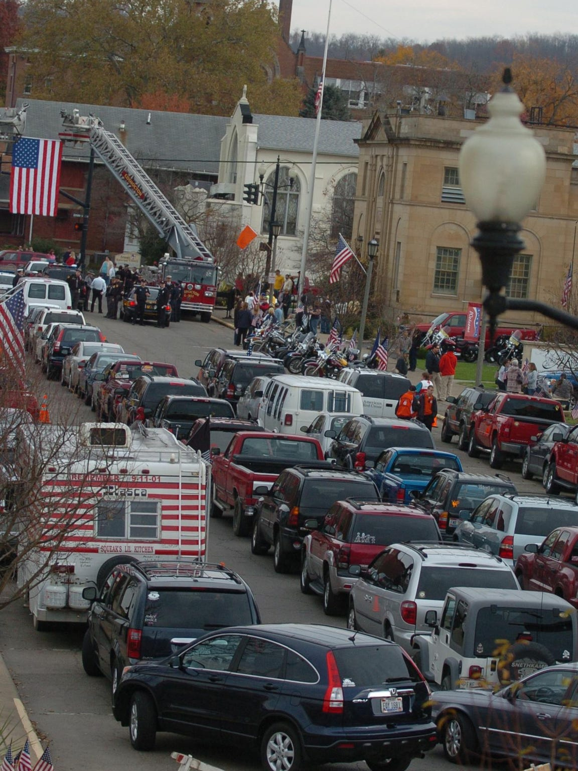 Cars line up in the 600 block of Main Street in front of Miller Funeral Home to take part in the funeral procession for U.S. Navy Builder Chief Petty Officer Raymond Border. The 31-year-old West Lafayette native was killed Oct. 19, 2011 in Paktika province, Afghanistan, while assisting with a road assessment for a convoy.