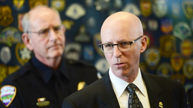 FBI representative Thomas Ravenelle answers questions from the media about a link between the I-25 shooting on April 22 and the May 18 murder of John Jacoby at the Windsor Police Department May 29, 2015 during a press conference.