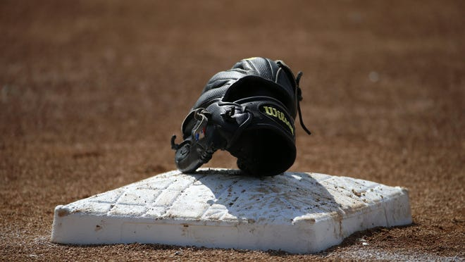 Presto web art sports baseball mittA Wilson baseball glove sits on third base during Baltimore Orioles batting practice before an exhibition spring training baseball game against the Philadelphia Phillies in Sarasota, Fla., Friday, March 7, 2014. (AP Photo/Gene J. Puskar)