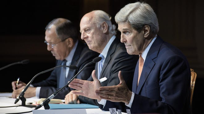 From left, Russian Foreign Minister Sergei Lavrov, UN Special Envoy for Syria Staffan de Mistura and Secretary of State John Kerry participate in a news conference in Vienna, Austria, Friday, Oct. 30, 2015. The U.S., Russia and more than a dozen other nations have directed the U.N. to begin a new diplomatic process with Syria's government and opposition with the goal of reaching a nationwide cease-fire and political transition.