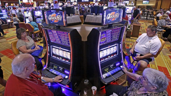 Patrons play some of the 600 slot machines at the Lady Luck Casino Nemacolin, located approximately 70 miles south of Pittsburgh.