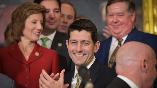 House Speaker Paul Ryan smiles during a press conference after the House passed its version of the Republican tax overhall on Thursday.