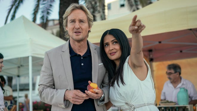 Greg (Owen Wilson) and Isabel (Salma Hayek) enjoy some time in the nicer of two worlds.