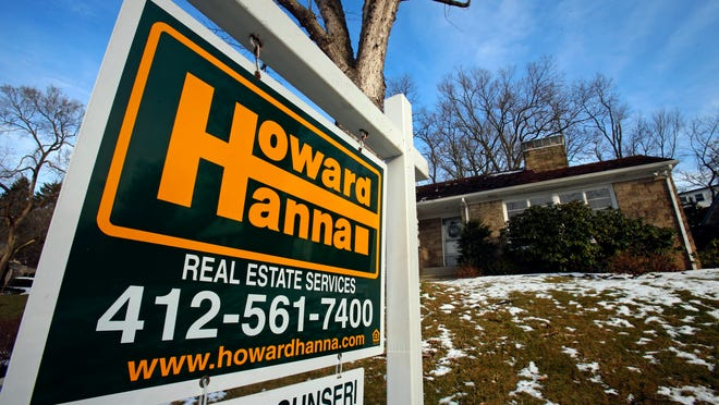 In this Thursday, Jan. 9, 2014 file photo, a for sale sign hangs in front of a house in Mount Lebanon, Pa. Freddie Mac reports on average U.S. mortgage rates on Thursday, May 1, 2014.
