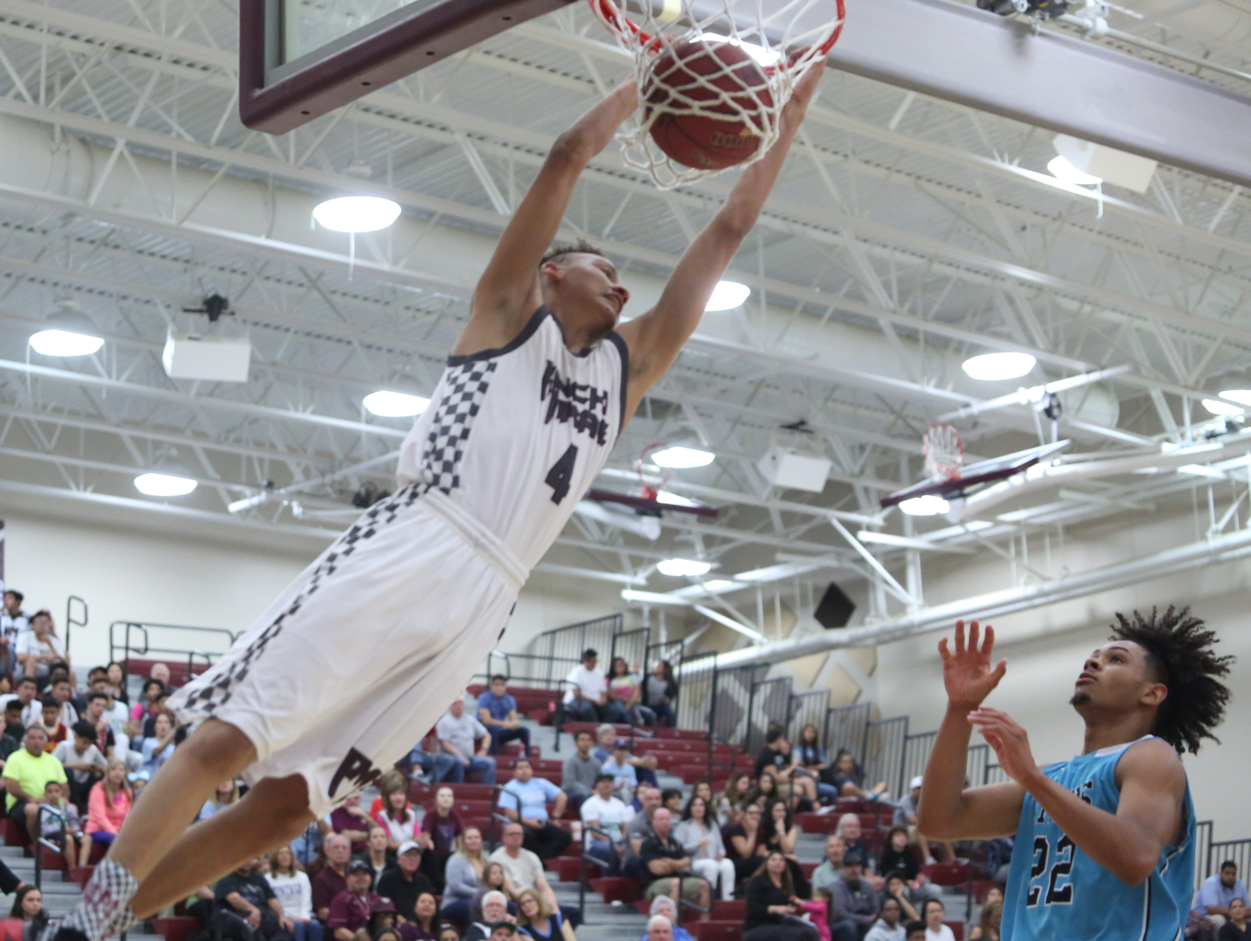 Rancho Mirage High School's Charles Neal dunks the ball during his team's win against Grand Terrace High School at Rancho Mirage on February 15, 2017. Rancho Mirage won the game 96-56.