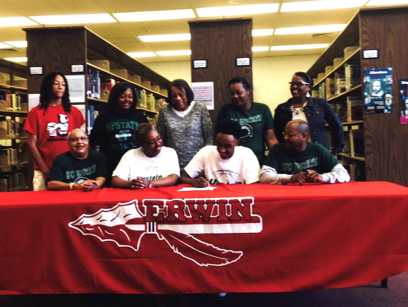 Erwin senior Malik Moore has signed to play college basketball for USC-Upstate.