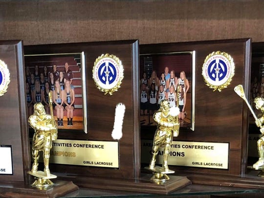 The Okemos girls lacrosse team added another conference