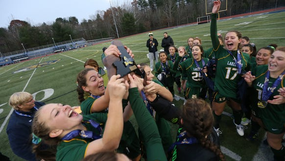Lakeland's players celebrated and lifted the NYSPHSAA