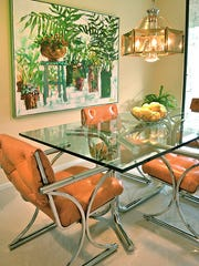 When decorating his kitchen, Scott Cole realized he had a wall large enough to display this colorful painting he had in storage.