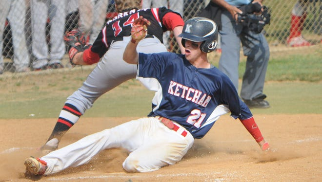 Roy C. Ketcham High School's Justin Squarzini slides safely into home past Fox Lane catcher Andrew Workman after evading a run down at third base during Wednesday's playoff game held at Ketcham.