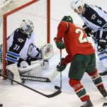 Winnipeg Jets goalie Ondrej Pavelec (31) makes a save as Minnesota Wild forward Thomas Vanek (26) looks for a rebound during the third period at Xcel Energy Center. The Jets defeated the Wild 2-0.