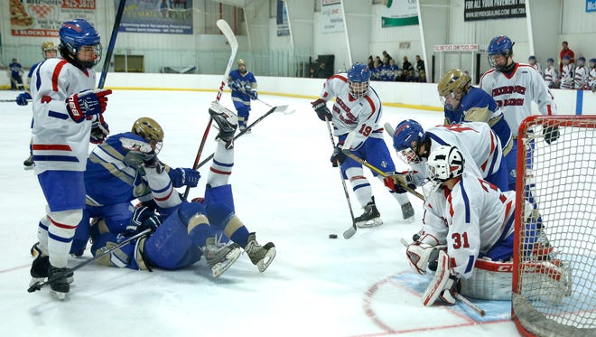 As Fairport's defends from Webster Schroeder's Anthony Giggie takes the puck in the first period at Thomas Creek Ice Arena in this file photo from January 2016.