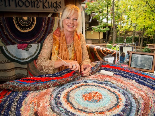 Laura White crochets rugs at the Silver Dollar City National Harvest & Cowboy Festival.