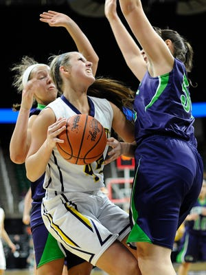 Dewitt's Lilly George (44) is fouled by Saginaw Heritage in the last second of the second quarter.
