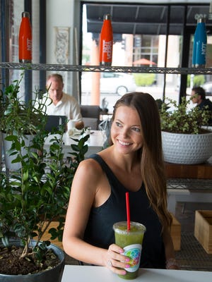 Alexandra Maw, owner of Kaleidoscope Juice, sits at her recently opened store in downtown Phoenix on Aug. 18, 2016. This is Maw's fourth juice bar.