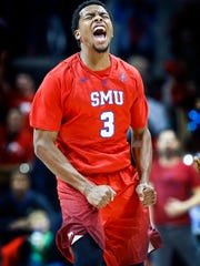 Southern Methodist University guard Sterling Brown celebrates a made 3-point shot against the University of Memphis defense during first half action at Moody Coliseum in Dallas on Saturday, March 4, 2017. The Tigers allowed the Mustangs to hit 10 first half 3-pointers leading to a 24-point halftime deafest. The Tigers also struggled to score against the Mustangs defense only hit 22-65 shots on the day, while shooting 15.4 percent 3-pointers and going 0-10 from beyond the arc in the first half.