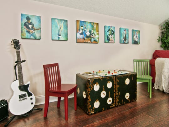 The Kuhar family wanted artwork that was fun and playful on the main wall in the upstairs playroom. Photographer Yvette Gioia played with the homeowner's rock 'n' roll theme and had each family member strike poses that showed off individual personalities.