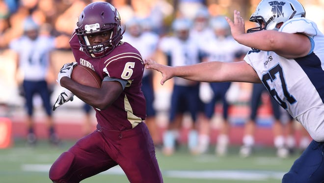 Arlington High School's Ricardo Yolas attempts to outrun John Jay's Anthony Mauro during a Sept. 16 game in Freedom Plains.