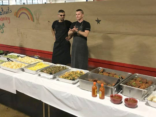 Metro Detroit Chefs John Vermiglio from Grey Ghost and George Azar from Flowers of Vietnam, used food provided by Forgotten Harvest to create a scrumptious dinner for the youth at the Downtown Boxing Gym.