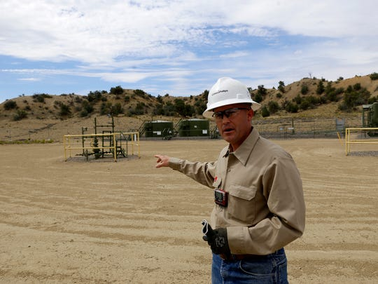 ConocoPhillips optimization technician Jamie Huffman talks about the company's efforts to reduce emissions on June 30 during a tour of a natural gas site in Aztec.