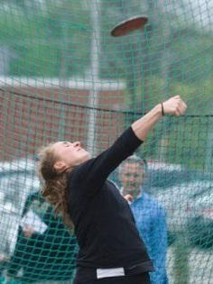 Milford senior Clare Cartheuser lets the discus fly.