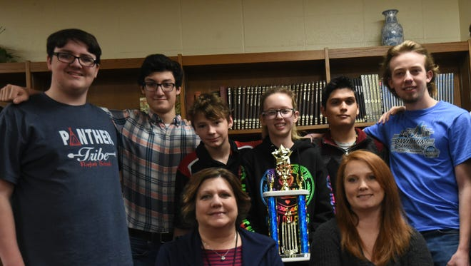 The Norfork High School Quiz Bowl recently won first place in the North Central Cooperative Senior High Quiz Bowl Tournament, Members of the team are: (first row, from left) coach Pam Braun, coach Stacy Havner, (second row) Bentley Branscum, Chris Staples, Thomas Lawhorn, Kristin Kite, Jaden Bennett, Elijah Hammond and Cody Foster.