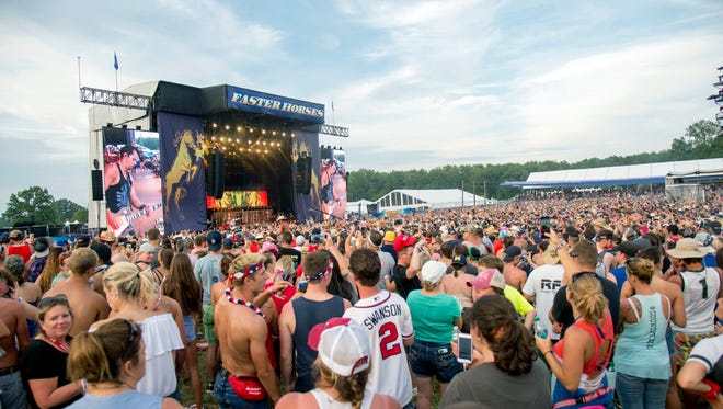 Festival goers attend the Faster Horses Music Festival in the Brooklyn Trails Campground at Michigan International Speedway on Friday, July 21, 2017, in Brooklyn, Mich. (Photo by Amy Harris/Invision/AP)