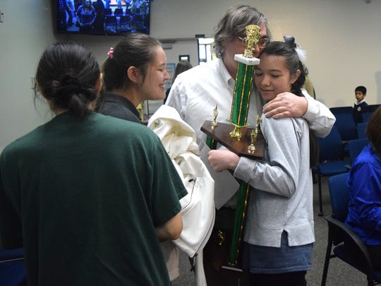 Marisa Langley, right, celebrates her spelling bee win with her family.