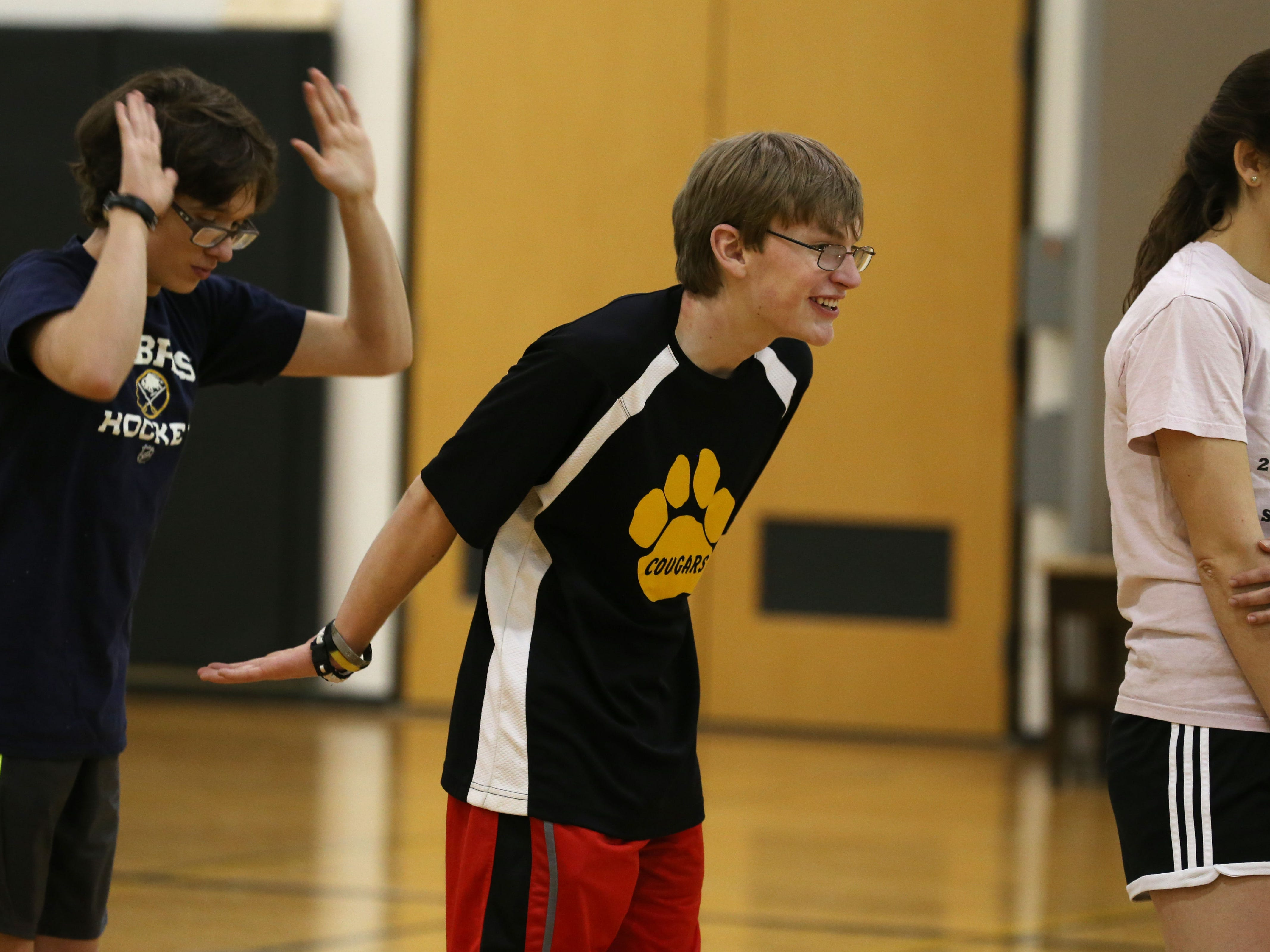 Gavin Germonto and teammate Skyler Smith give each other props on free throw shooting during the second practice for Honeoye Falls-Lima's unified basketball team.