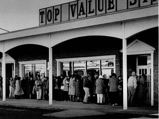 This 1982 photo shows a line of Top Value stamp savers waiting outside the redemption center at 3400 Monroe Ave., Pittsford. The stamp savers had a three-hour wait after Star Supermarkets announced it would no longer distribute trading stamps.