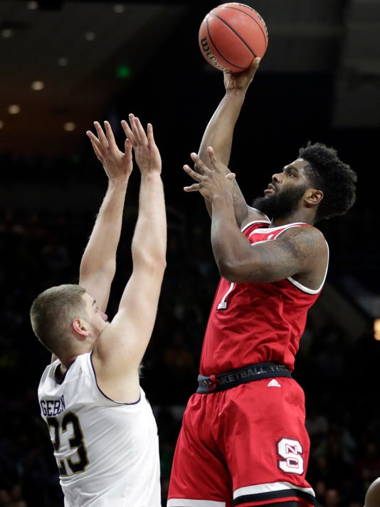 Notre Dame forward Austin Torres (1) shoots over Notre Dame forward Martinas Geben (23) during the first half of an NCAA college basketball game in South Bend, Ind., Wednesday, Jan. 3, 2018. (AP Photo/Michael Conroy)