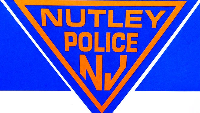 Side shot of a Nutley Police Department vehicle, car. Logo.