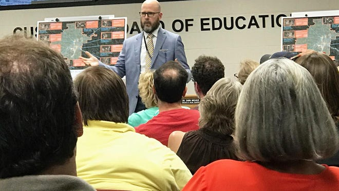 District 205 Superintendent John Asplund answers questions from school residents during a 2018 question and answer session about school building options. Asplund received a five-year contract extension last week from the school board.