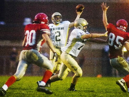 James Dougherty, center, ranked second in the YAIAA in passing yards last season.