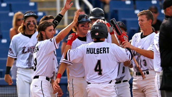 Peoria Liberty's Cody Hulbert is greeted by teammates following his solo home run in the second inning of a Division I state tournament game at Maryvale Baseball Stadium on  Wednesday, May 13,  2015, in Phoenix. Liberty beat Corona del Sol  5-2.