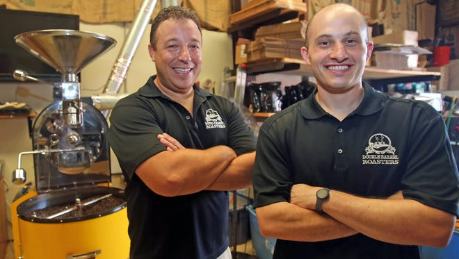 From left, Ross Farman of Tarrytown, and Chris Tortu of Yonkers, owners of Double Barrel Roasters are photographed at their shop in Yonkers.